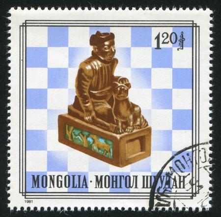 MONGOLIA - CIRCA 1981: stamp printed by Mongolia, shows wood chess piece, circa 1981 photo