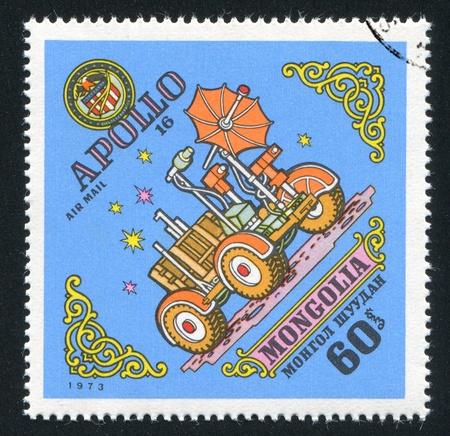 exploratory: MONGOLIA - CIRCA 1973: stamp printed by Mongolia, shows Apollo 16 moon rover, circa 1973 Stock Photo