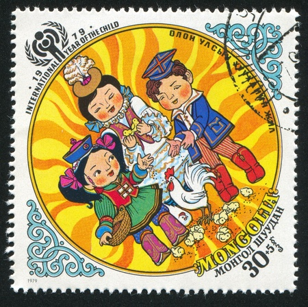 childen: MONGOLIA - CIRCA 1979: stamp printed by Mongolia, shows Childen Feeding Chicken, circa 1979