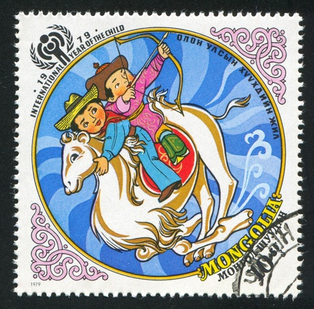 MONGOLIA - CIRCA 1979: stamp printed by Mongolia, shows children and camel, circa 1979