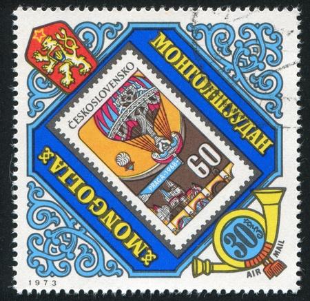 MONGOLIA - CIRCA 1973: stamp printed by Mongolia, shows Prague and parachute, circa 1973 photo