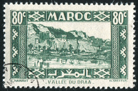 FRENCH MOROCCO - CIRCA 1942: stamp printed by Morocco, shows Valley of Draa, circa 1942 photo