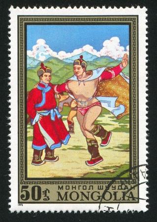 MONGOLIA - CIRCA 1972: stamp printed by Mongolia, shows mongolian wresting, circa 1972 photo