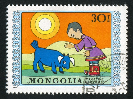 disobedient: MONGOLIA - CIRCA 1975: stamp printed by Mongolia, shows boy and disobedient bull calf, circa 1975