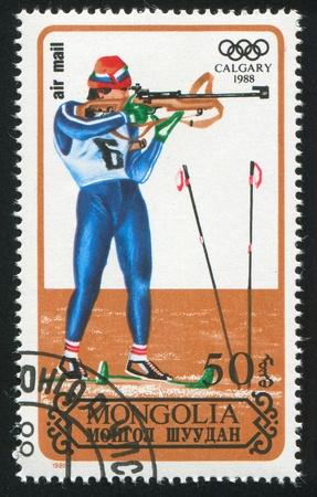 MONGOLIA - CIRCA 1988: stamp printed by Mongolia, shows winter Olympic game Calgary, biathlon, circa 1988