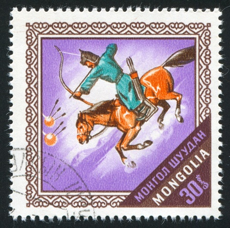 MONGOLIA - CIRCA 1974: stamp printed by Mongolia, shows Archer on horseback, circa 1974 photo