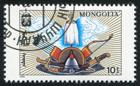 slasher: MONGOLIA - CIRCA 1990: stamp printed by Mongolia, shows armour and cold weapon, circa 1990 Stock Photo