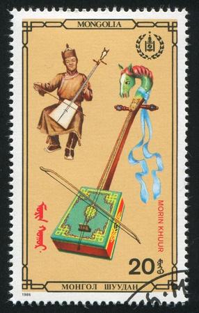 MONGOLIA - CIRCA 1986: stamp printed by Mongolia, shows morin khuur, circa 1986 photo