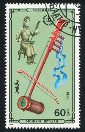 cilinder: MONGOLIA - CIRCA 1986: stamp printed by Mongolia, shows khiil, circa 1986 Stock Photo