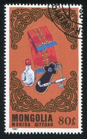 MONGOLIA - CIRCA 1987: stamp printed by Mongolia, shows Pouches, bottle, pipe, circa 1987 photo