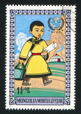 MONGOLIA - CIRCA 1977: stamp printed by Mongolia, shows Walking boy, circa 1977 photo