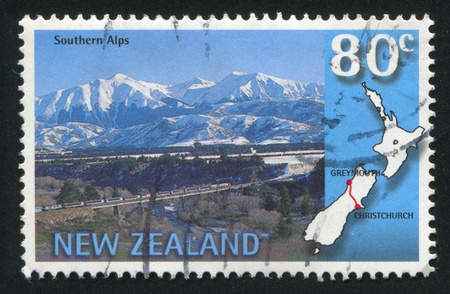 NEW ZEALAND - CIRCA 1997: stamp printed by New Zealand, shows Trans-Alpine scenic train, Southern Alps, Christchurch-Greymouth, circa 1997 Stock Photo - 12787802