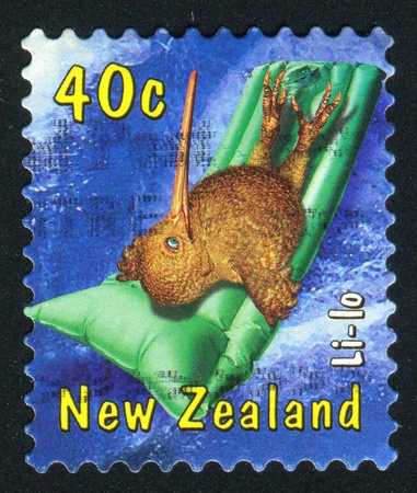 NEW ZEALAND - CIRCA 2000: stamp printed by New Zealand, shows Inflatable beach cushion, circa 2000 photo