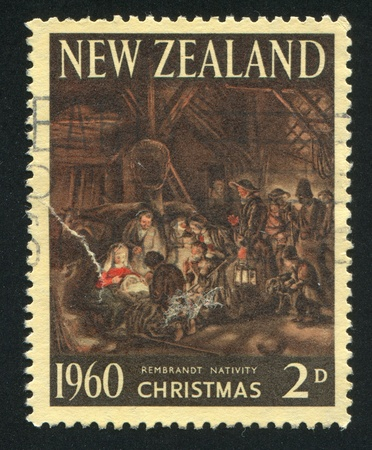NEW ZEALAND - CIRCA 1960: stamp printed by New Zealand, shows Adoration of the Shepherds, by Rembrandt, circa 1960 Stock Photo - 12787564