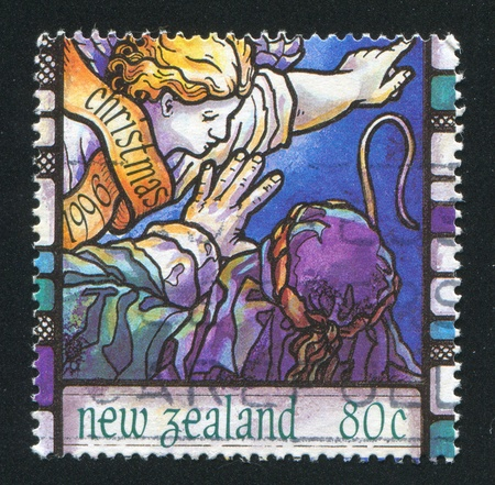 NEW ZEALAND - CIRCA 1996: stamp printed by New Zealand, shows Scenes from the Christmas story, Angels announcement to shepherd, circa 1996 photo
