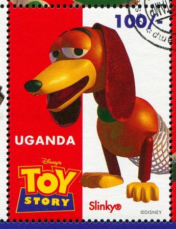 slinky: UGANDA - CIRCA 1997: stamp printed by Uganda, shows Toy Story, Slinky Dog, circa 1997.