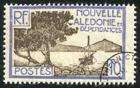 NEW CALEDONIA - CIRCA 1928: stamp printed by New Caledonia, shows Bay of Paletuviers Point, circa 1928 Stock Photo - 12998969