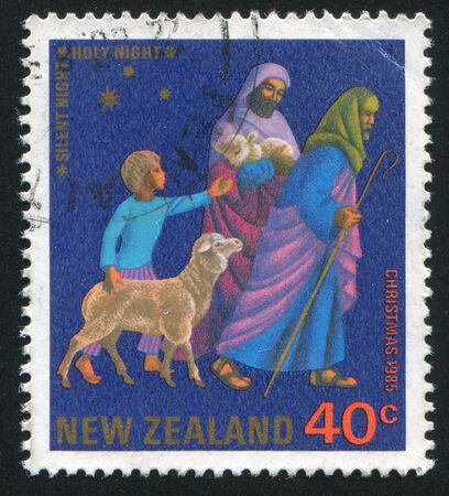NEW ZEALAND - CIRCA 1985: stamp printed by New Zealand, shows Travellers with Sheep and a Boy, circa 1985 Stock Photo - 12998942