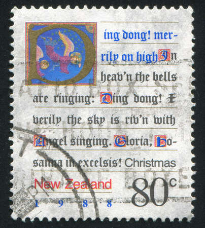 new zealand word: NEW ZEALAND - CIRCA 1988: stamp printed by New Zealand, shows Written Christmas Carol and a Picture of Angels, circa 1988