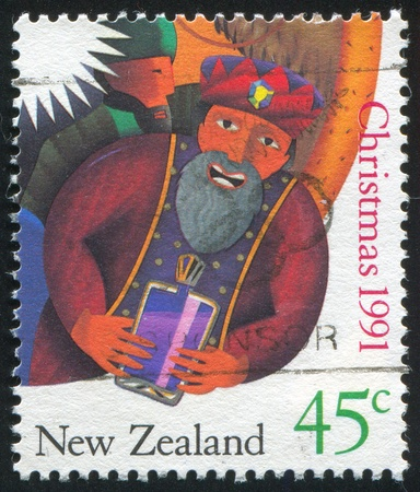 NEW ZEALAND - CIRCA 1991: stamp printed by New Zealand, shows Man Holding a Gift, circa 1991 photo