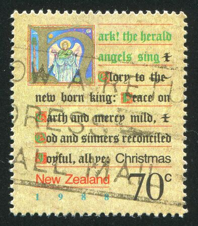 new zealand landscape: NEW ZEALAND - CIRCA 1988: stamp printed by New Zealand, shows Written Christmas Carol and a Picture of an Angel, circa 1988