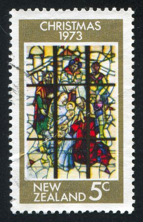 christmas religious: NEW ZEALAND - CIRCA 1973: stamp printed by New Zealand, shows Stained Glass Window on Religious Subject, circa 1973 Stock Photo