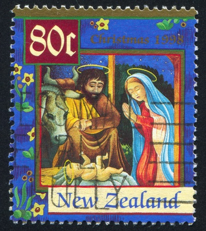NEW ZEALAND - CIRCA 1998: stamp printed by New Zealand, shows Joseph, Mary and Christ Child, circa 1998 Stock Photo - 12999463
