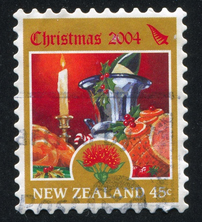 NEW ZEALAND - CIRCA 2004: stamp printed by New Zealand, shows Christmas Festive Table, circa 2004 photo