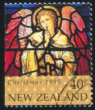christmas church: NEW ZEALAND - CIRCA 1995: stamp printed by New Zealand, shows Stained Glass Window Depicting Angel with Trumpet, circa 1995