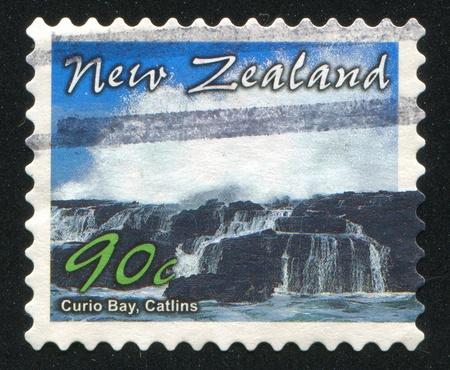 curio: NEW ZEALAND - CIRCA 2002: stamp printed by New Zealand, shows Scenic Coastlines, Curio Bay, Catlins, circa 2002 Stock Photo