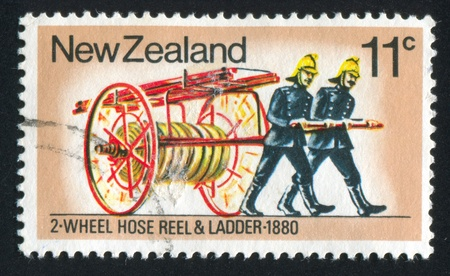 collaborator: NEW ZEALAND - CIRCA 1977: stamp printed by New Zealand, shows Fire Fighting Equipment: 2-wheel hose reel and ladder, circa 1977