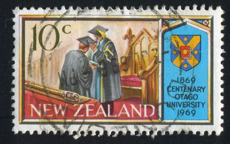 conferring: NEW ZEALAND - CIRCA 1969: stamp printed by New Zealand, shows Centenary of the University of Otago: Conferring degree and arms of the University, circa 1969 Editorial