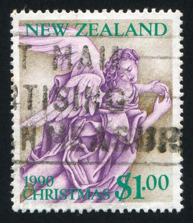 NEW ZEALAND - CIRCA 1990: stamp printed by New Zealand, shows angel, circa 1990 photo