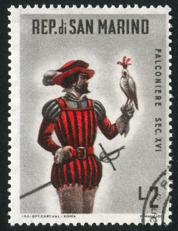 SAN MARINO - CIRCA 1961: stamp printed by San Marino, shows Mounted falconer, circa 1961 photo