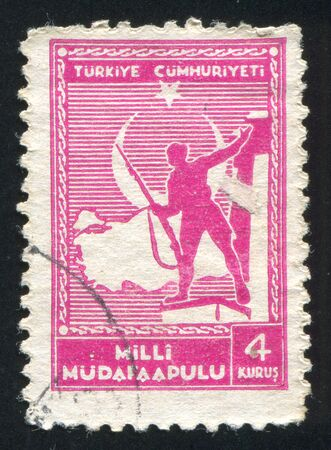 TURKEY- CIRCA 1941: stamp printed by Turkey, shows Soldier and Map of Turkey, circa 1941 photo