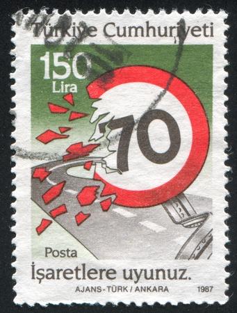 TURKEY - CIRCA 1987: stamp printed by Turkey, shows road safety, observe speed limit,  circa 1987 photo