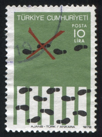TURKEY - CIRCA 1987: stamp printed by Turkey, shows road safety, pedestrian crossing,  circa 1987 photo