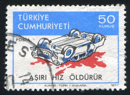 TURKEY - CIRCA 1978: stamp printed by Turkey, shows road safety, wrecked car,  circa 1978 Stock Photo - 12999384