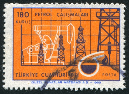 TURKEY - CIRCA 1969: stamp printed by Turkey, shows Oil industry chart and symbols, circa 1969 Stock Photo - 12999466
