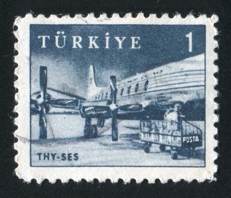 TURKEY - CIRCA 1959: stamp printed by Turkey, shows Turkish Airlines SES plane, circa 1959 photo