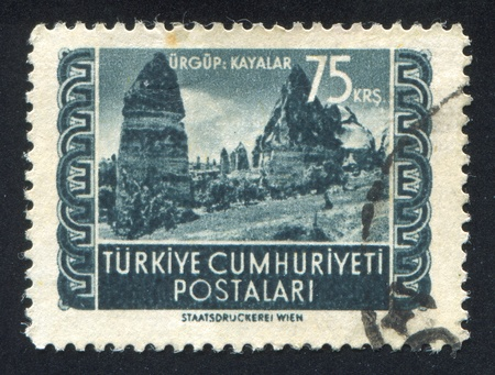 TURKEY - CIRCA 1952: stamp printed by Turkey, shows rocks, Urgup, circa 1952 Stock Photo - 12999044
