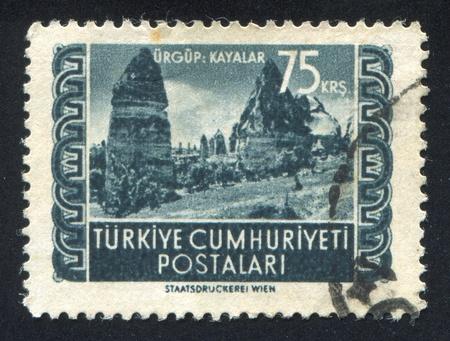 TURKEY - CIRCA 1952: stamp printed by Turkey, shows rocks, Urgup, circa 1952 Stock Photo - 12999044