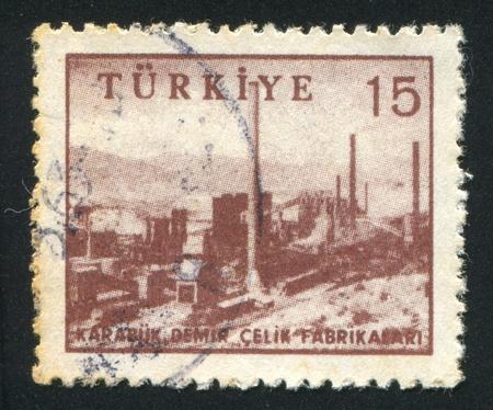 TURKEY - CIRCA 1959: stamp printed by Turkey, shows iron and steel works, Karabu, circa 1959 photo