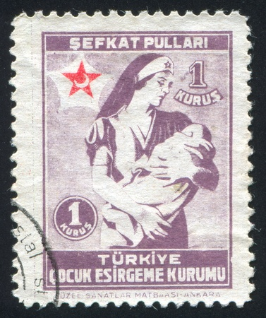TURKEY- CIRCA 1943: stamp printed by Turkey, shows child and sister, circa 1943 Stock Photo - 12999369