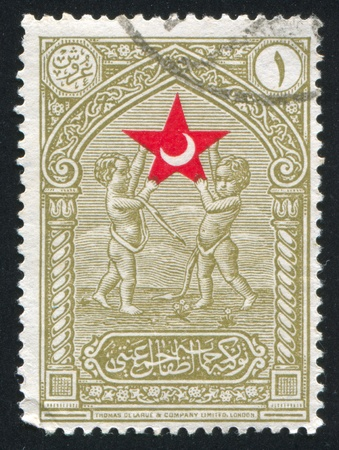 upholding: TURKEY - CIRCA 1932: stamp printed by Turkey, shows Cherubs upholding star, circa 1932