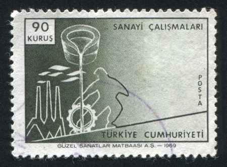 TURKEY- CIRCA 1969: stamp printed by Turkey, shows Pouring ladle and industrial symbols, circa 1969 Stock Photo - 12999327