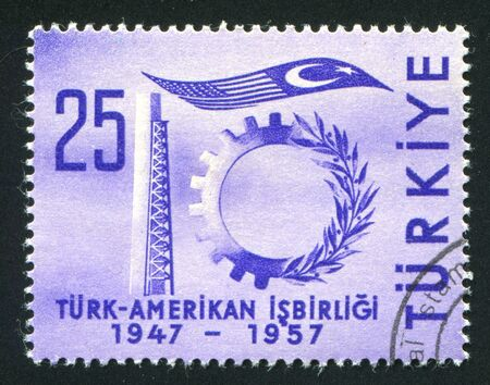 asterix: TURKEY- CIRCA 1957: stamp printed by Turkey, shows symbols of industry and flags, circa 1957 Stock Photo