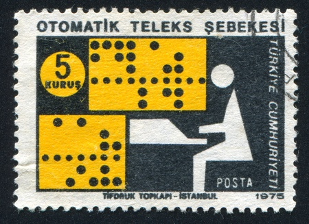 TURKEY- CIRCA 1975: stamp printed by Turkey, shows automatic telex network, circa 1975 photo