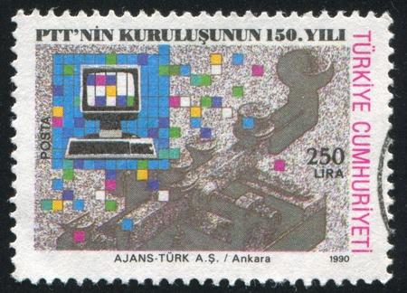 TURKEY- CIRCA 1990: stamp printed by Turkey, shows Telegraph key, computer terminal, circa 1990 photo