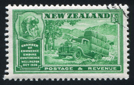 NEW ZEALAND - CIRCA 1936: stamp printed by New Zealand, shows Chamber of Commerce Empire Conference Wellington, Wool Industry, circa 1936 photo